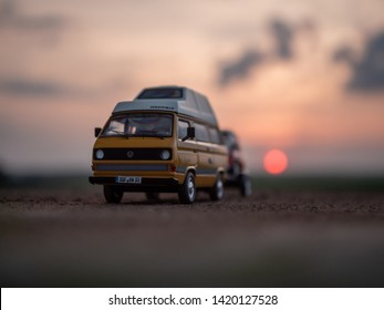 NITRA, SLOVAKIA - JUNY 09 2019: Volkswagen Transporter T3 with trailer by summer sunset. Scale model Volkswagen Transporter 1:43. Classic car with trailer.