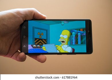 Nitra, Slovakia, March 20, 2017: The Simpsons Tapped Out application logo on smartphone
