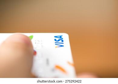 NITRA, SLOVAKIA - MAY 4, 2015: Man holding visa bank credit card