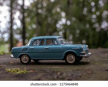 NITRA, SLOVAKIA - SEPTEMBER 01 2018: Scale model SKODA 1000 in summer forest. Classic car SKODA 1000 closeup photo. Retro car in forest.