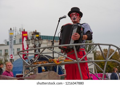 Nitra, Slovakia - September 22, 2012: An artist clown playing on an acordeon in Nitra Slovakia