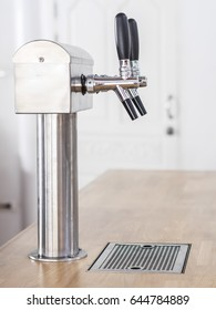 Nitro cold brew coffee machine on the wooden bar.