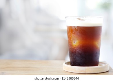 Nitro Cold Brew Coffee on wooden table and copy space