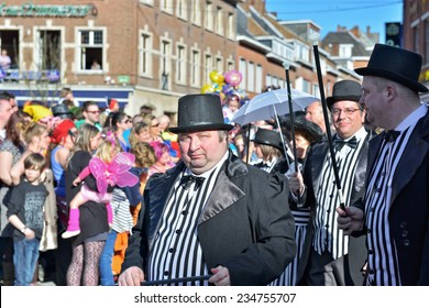 NIVELLES, BELGIUM-MARCH 03, 2014: Group in fancy dresses participates in defile during yearly carnival in Nivelles