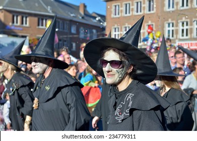 NIVELLES, BELGIUM-MARCH 03, 2014: Group in costumes of witches participates in defile during yearly carnival in Nivelles