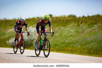 Niwot, CO, USA - June 26, 2016: Two cyclists break away from the peloton in the Senior Men Pro/Category-1/Category-2 race at the Niwot Circuit Race.