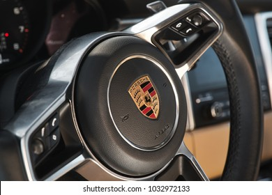 NIZHNIY NOVGOROD, RUSSIA -  19 2018: Private car, Porsche Macan. Steerwheel with logo.