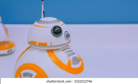 NIZHNIY NOVGOROD, RUSSIA - August 7, 2017: The Exhibition Park Of Robots. Droid BB-8 from StarWars rolling on white table at technology show