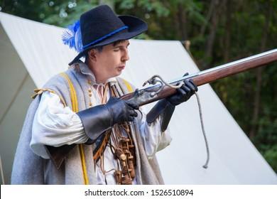 NIZHNIY NOVGOROD, RUSSIA - JUNE 2018: Volga Shtandart Historic Festival. Musketeer preparing to fire muskets at reenactment festival