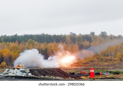 Nizhniy Tagil, Russia - September 27. 2013: Russia Arms Expo-2013 exhibition. TOS-1A system from fighting and resupply vehicles attacks target. Uralvagonzavod production
