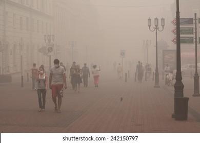 NIZHNY NOVGOROD - AUGUST 15, 2010: people walk on pedestrian street Bolshaya Pokrovka in Nizhny Novgorod, Russia on 8th August, 2010 under very strong smog because of forest fires near the city