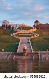 "Nizhny Novgorod. Chkalov staircase, military boat ""Hero"" and the Kremlin - the view from the Volga May evening at sunset"