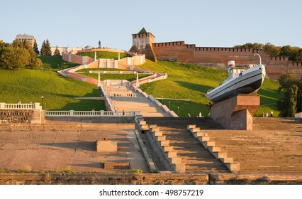 """Nizhny Novgorod city, Russia. A panoramic view of the Chkalov Staircase and the ship """"Hero"""" on the background of the Novgorod Kremlin, in the sunset light."""