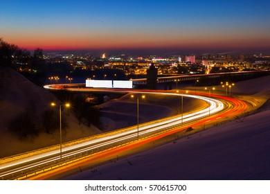 Nizhny Novgorod, the light of car headlights on metro bridge