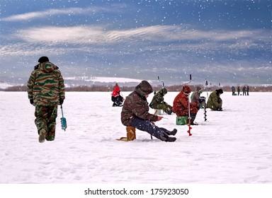 Nizhny Novgorod region, Russia - February 8, 2014: Fishermen on the ice fishing on the river Oka
