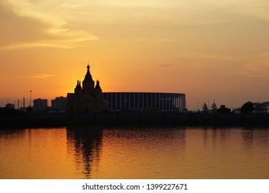 Nizhny Novgorod, Nizhny Novgorod Region / Russia - May 14 2019: sunset overlooking the stadium and the church in Nizhny Novgorod