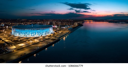 "Nizhny Novgorod / russia - 04.16.2018 City landscape at sunset. The stadium ""Nizhny Novgorod"" Fifa. The confluence of the rivers of the Volga and the Oka."