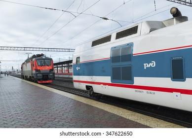 NIZHNY NOVGOROD, RUSSIA -05.11.2015. The locomotive pulls the train Strizh at the station