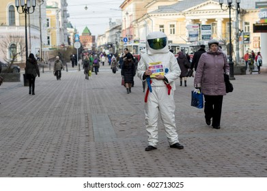 Nizhny Novgorod, Russia - 17 March 2017: A young man in an astronaut suit, handing out leaflets on the street .