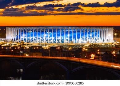 """Nizhny Novgorod, Russia, April 2018: Kanavinsky bridge over the river Oka, the stadium """"Nizhny Novgorod"""", Nizhny Novgorod at sunset, remarkable view from the Gremyachaya mountain."""