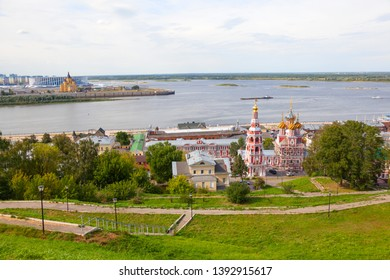 Nizhny Novgorod, Russia - Aug 15, 2018: View towards the Cathedral of the blessed virgin, the confluence of the Oka river and the Volga river. In the background, the Cathedral of Alexander Nevsky