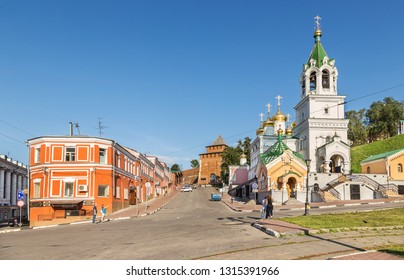 Nizhny Novgorod, Russia - August 18, 2018: View on street and Minin and Pozharsky monument, Ivanovskaya Tower, church and Kremlin wall