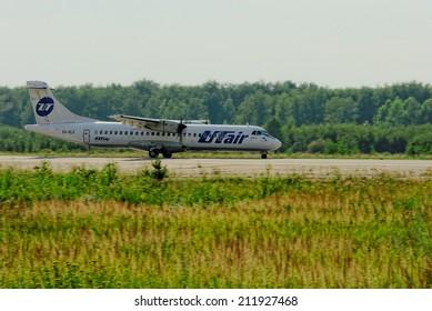NIZHNY NOVGOROD. RUSSIA. JULY 31, 2014. STRIGINO AIRPORT.  The passenger ATR-72 plane of the UTair company on a runway