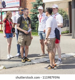 Nizhny Novgorod, Russia - June 24, 2018: It one of the cities of the World Cup 2018 in Russia. Volunteers answer questions from fans