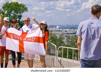 "NIZHNY NOVGOROD. RUSSIA. JUNE 24, 2018. FIFA-2018. The English fans are photographed against the background of stadium ""Nizhny Novgorod"""