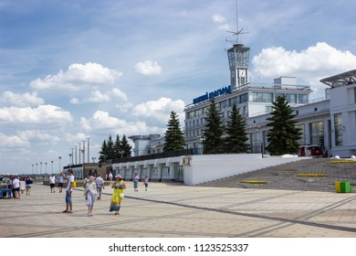 Nizhny Novgorod, Russia - June 24, 2018: River station on the embankment of the Volga, tourists are walking near it