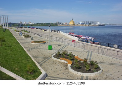 Nizhny Novgorod, Russia - June 24, 2018: Embankment of the Volga River in Nizhny Novgorod, from which the new stadium and cathedral are beautifully seen