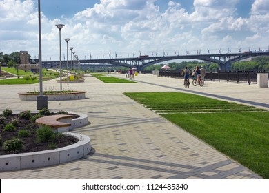 Nizhny Novgorod, Russia - June 24, 2018: Embankment of the Volga River in Nizhny Novgorod, in the distance you can see the oldest bridge in the city