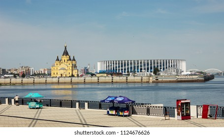 Nizhny Novgorod, Russia - June 24, 2018: Beautiful view from Volga Embankment of new stadium and a cathedral