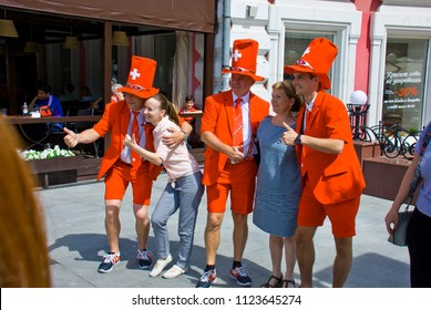 NIZHNY NOVGOROD. RUSSIA. JUNE 27, 2018. FIFA-2018. Fans from Switzerland in bright suits are photographed with citizens.