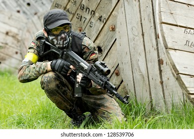 NIZHNY NOVGOROD, RUSSIA - MAY 13: Airsoft player waiting in ambush on may 13,2012 in shooting ground near Nizhny Novrogorod, Russia. Airsoft is a recreational activity with replica firearms.