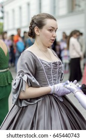 NIZHNY NOVGOROD, RUSSIA  May 20, 2017: Night of museums festival. Young girl photographed and posing in a ball gown of the early 20th century in the Russian Museum. NIZHNY NOVGOROD