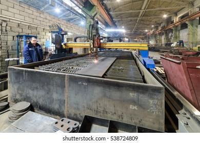 NIZHNY NOVGOROD, RUSSIA - NOVEMBER 28, 2016: CNC gas cutting machine oxy acetylene cutting steel sheets.