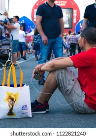 Nizhny Novgorod, Russia-June 24, 2018: football fans came to Nizhny Novgorod for the world Cup. England - Panama. Fan resting sitting in the square with the logo of the World Cup 2018.