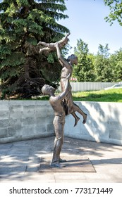 Nizhny Tagil, Russia - June 17, 2015: Sculpture of a family in a park in the city of Nizhny Tagil