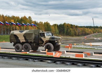 Nizhny Tagil, Russia - Sept 11, 2015:  Army truck URAL-4320 on obstacle at firing range. Display of fighting opportunities of arms and military equipment of land forces on 10 Russia Arms Expo