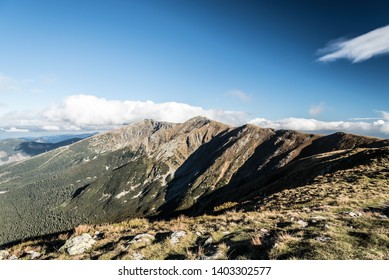 Nizke Tatry mountains with rocky Derese and Chopok mountain peaks from Polana hill in Slovakia during beuatiful autumn day