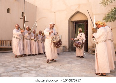 Nizwa Fort, Nizwa / Sultanate of Oman - Feb 15 2018: Omani men dancing a traditional sword dance at Nizwa Fort.