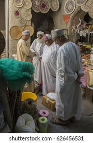 Nizwa, Oman, 26th May, 2016: local men shopping at a market