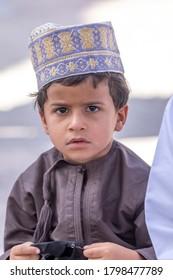 Nizwa, Oman, April 24, 2015 - Omani boy attending the goat auction at the Nizwa market