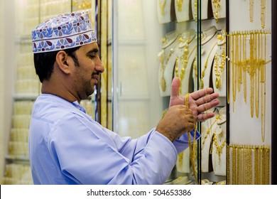 NIZWA, OMAN - APRIL 24 2015: Omani Jeweler checking the ornaments at his shop in Nizwa, Oman