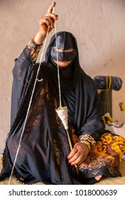nizwa, Oman, Febrary 2nd, 2018: omani woman spinning a yarn