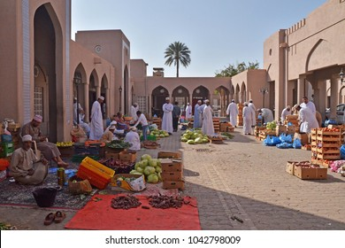NIZWA, OMAN - FEBRUARY 2018: Men sales their products in the vegetable market in Nizwa town, Oman, on February 23, 2018 in Nizwa