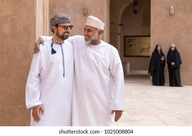 Nizwa, Oman, February 2nd, 2018: omani men in traditional clothing greeting each other