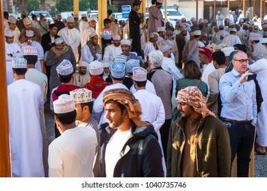 Nizwa, Oman - February  9th, 2018: people are gathering before traditional Habta Market where goats are sold, bought and exchanged the traditional way every Friday in Nizwa