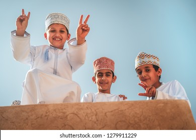 NIZWA - OMAN / MARCH 2018: Candid portraits of kids in the Nizwa fort